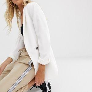 White blazer with black single button